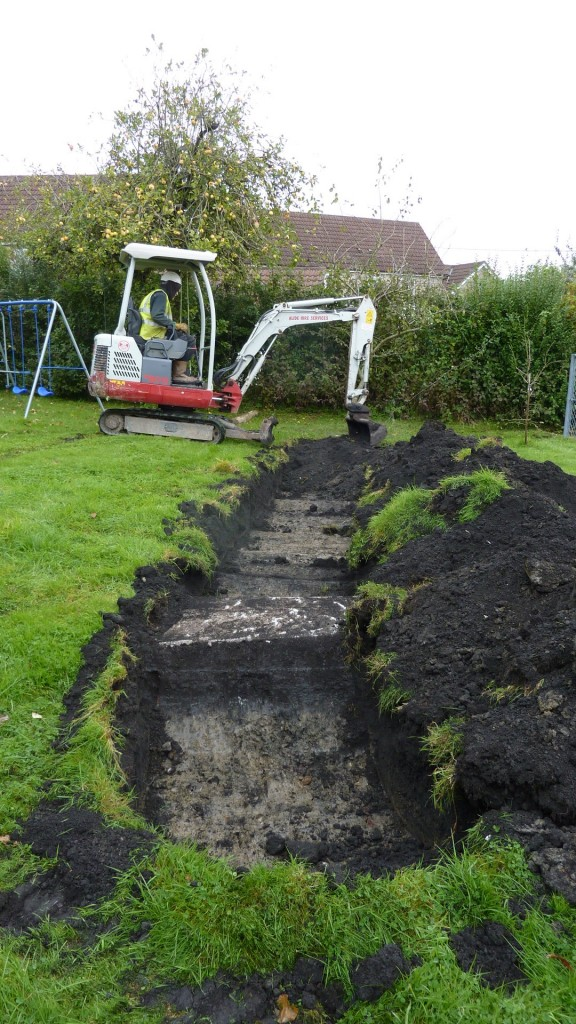 Shallow trenching with mini digger to locate mine shaft in foot print on new house