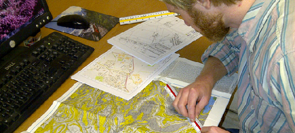One of Geoinvestigates mining specialists carrying out a CMRA desk study