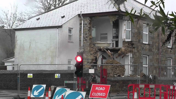 Collapse of corner of building caused by mine shaft subsidence. Building damage is rare and injury even rarer